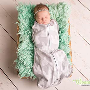 The Woombie's ergonomic, peanut-shaped design gently hugs baby recreating the feeling of the womb.