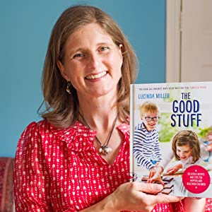 author, lucinda miller, holding her book