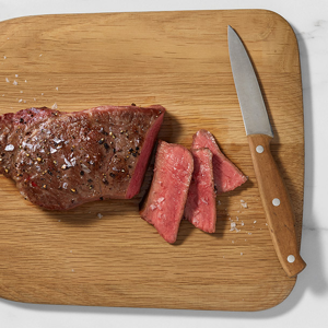 June steak on chopping board