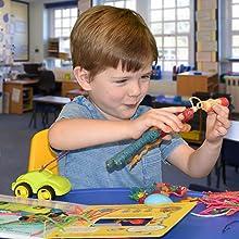 boy with 3D Wikki Stix toy