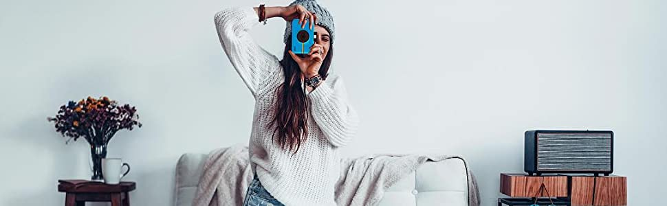 woman taking photo with blue camera