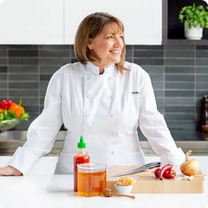Michelin-star chef Gale Gand in her kitchen preparing Sriracha Honey Beef Jerky