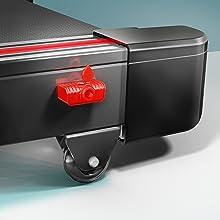 El área lateral de la cinta muestra las ruedas de transporte y el dispensador rojo de