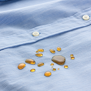 dark liquid droplets pooling on shirt but not being absorbed