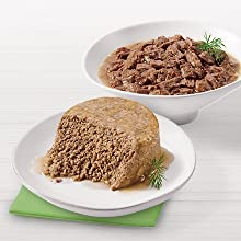 Plate of wet cat food pate and bowl of tender cuts in gravy