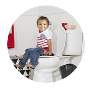 Kid sitting on a Family Toilet