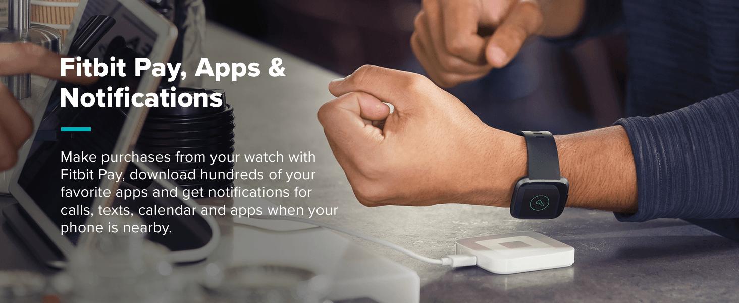 Man scanning fitbit Versa 2 watch at cash resister