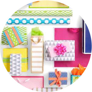 Colorful wrapping paper, bows, ribbon, tissue paper and gift bags by Hallmark