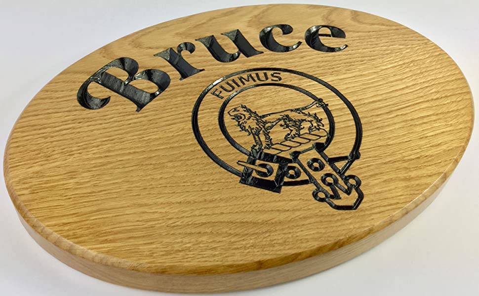 This is an image of a finished Personalised oval house sign and family crest and the wording Bruce