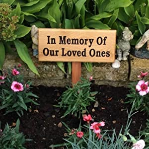 wooden house sign for in the memory of our loved ones