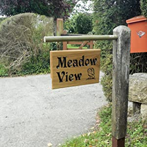 Hanging house sign with called meadow View and an image of an owl