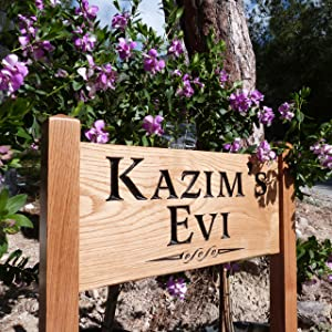Small ladder house sign called Kazims evi
