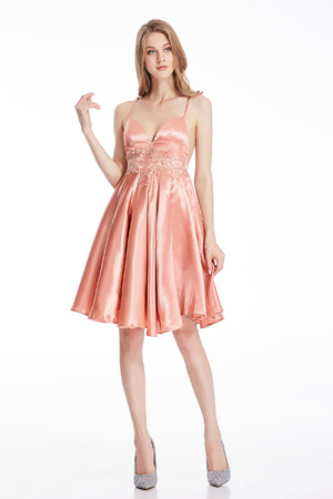 This satin cocktail dress features spaghetti straps ,sweetheart,backless design and elastic band closure.