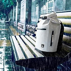 Graneberg PC rucksack standing in the rain