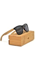 f9fc576ba3fc ... Zebra wooden sunglasses for men and women with dark grey polarised  lenses ...