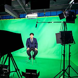 man infront of LED screen with green screen background with Fovitec LED Lighting the room and him