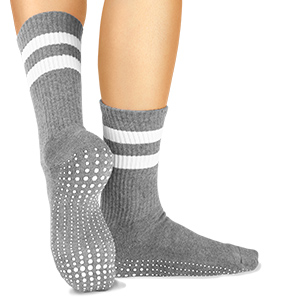 Gray ballet sock on model showing custom white traction yoga grip pattern