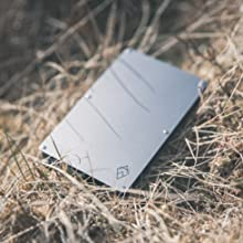 silver rfid credit card protector wallet on the ground