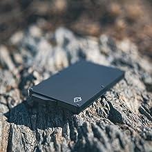 black aluminium credit card holder wallet on the ground