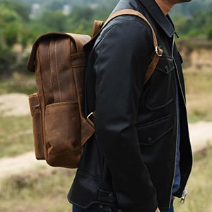 The Crazy horse leather darkens with usage and makes it more attractive.  This stylish backbag is perfect for your 14 inch laptop. a9eb0c981239f