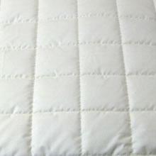 Merino Schafschurwolle Kopfkissen in 40x80 cm mit 450 Gramm Schurwoll Kügelchen zur individuellen Höhenverstellung und unterstepptem Baumwollbezug