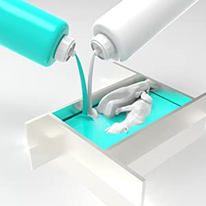 Silikon gießen im Formbaurahmen mit einem Gegenstand darin.