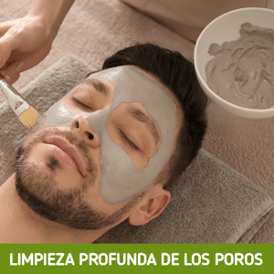 man having clay mask put on his face
