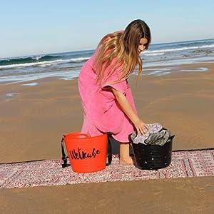 Con Wetkube mantienes tu traje limpio de arena y suciedades