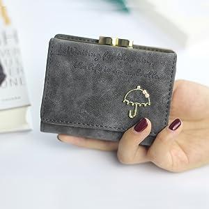 mujer carteras y monederos