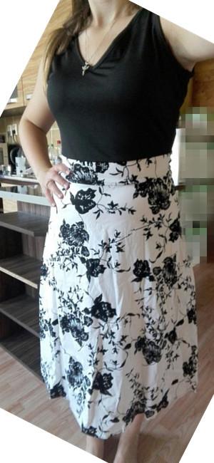 Vestido vintage clásico estilo años 50s Audrey Hepburn la impresión floral y lunar de la vendimia en la falda le da una mirada retra y elegante.
