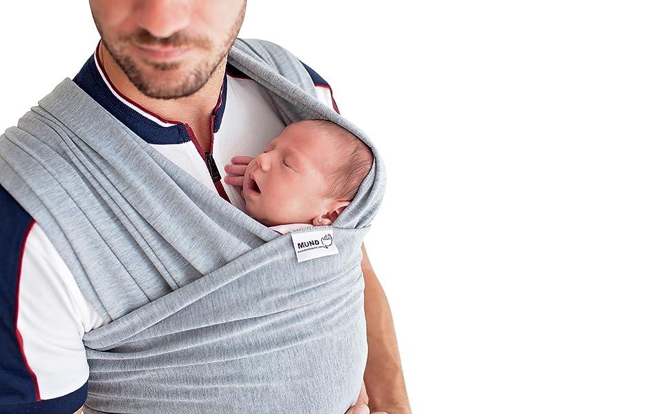 Llévate a tu bebé contigo a todas partes con este cómodo fular portabebés semielástico.
