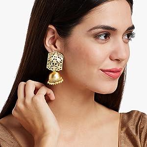 Model wearing jhumka earrings