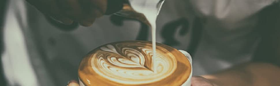 Milk Froth into coffee cup cappucino latte