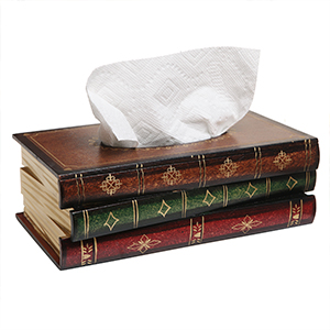 tissue box cover holder that looks like a stack of three antique books with white tissue coming out