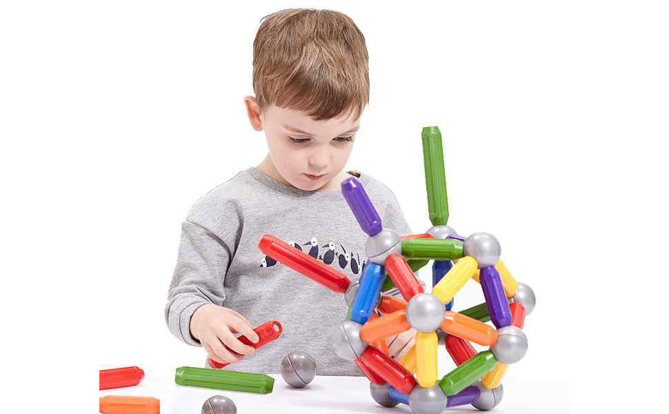 A boy is playing our magnetic building rods