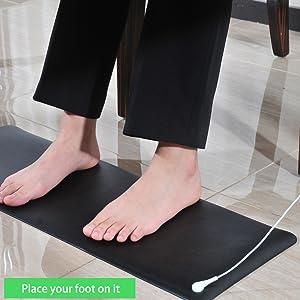 foot on mat