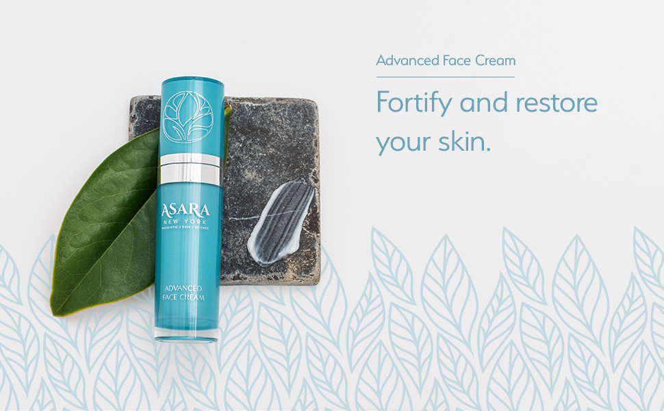 Asara Advanced Face Cream sitting on stone coaster with leaf. Fortify and restore your skin.