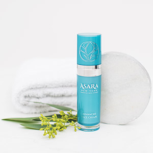 Asara Advanced Face Cream on white background with towel and green leaves.
