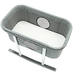 A photo of our rocking bassinet with included bassinet mattress pad