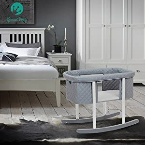 A photo of our bedside bassinet with included bassinet mattress
