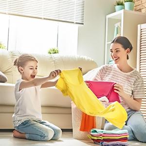 child folding clothes