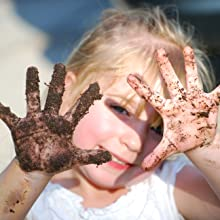 Little girl planting garden