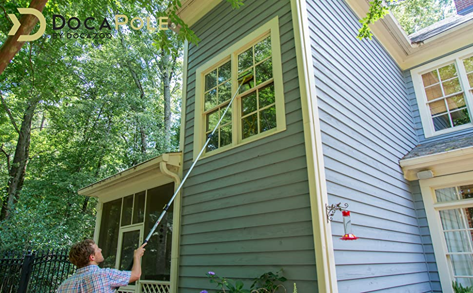 DocaPole 12' Pole with DocaPole Window Squeegee and Window Scrubber Combo cleaning 2nd story window