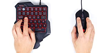 Hands on the keypad and gaming mouse