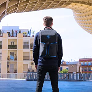 Man wearing backpack while facing away from camera