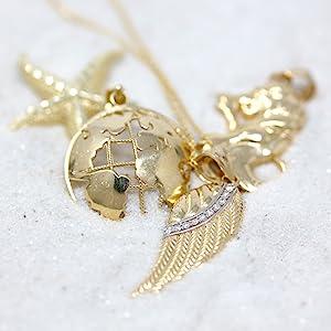 globe angel wing pendant necklace