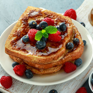 Syrup with berries on French Toast