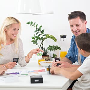 family playing an educational card game board game learning geography with flags and a world map