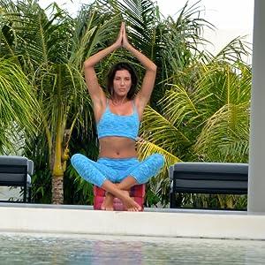 yoga zen meditation kundalini practice on cushion bolster block for hip support