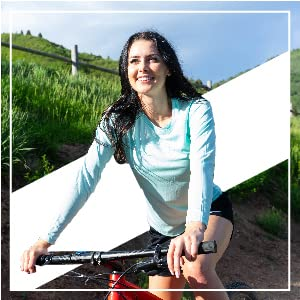 Girl riding mountain bike in a bright hilly mountainous area.
